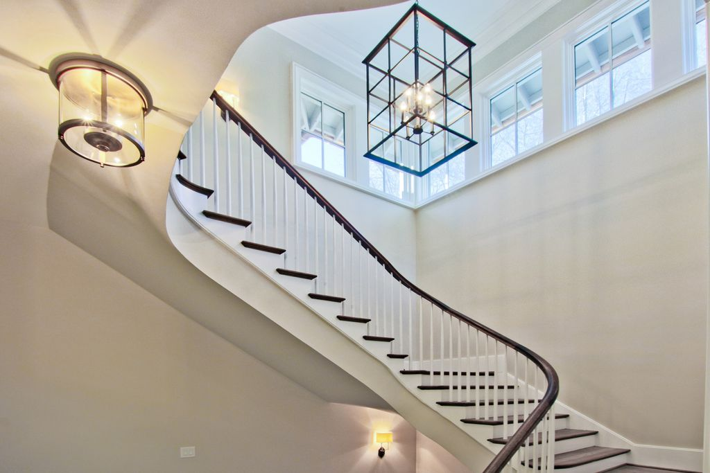 Beautiful open stairwell with wooden banister